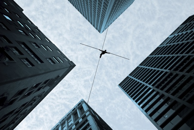Tightrope walker concept of risk taking and challenge